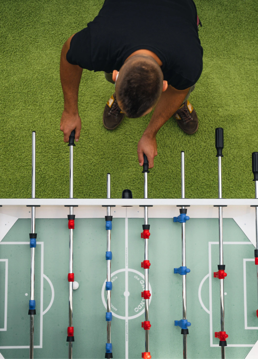 Guy playing Table football seen from above