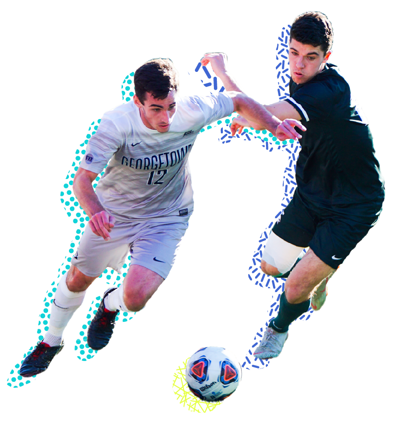 Two guys playing soccer rushing to catch the ball